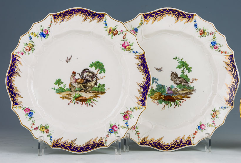 Two Hague-decorated Tournai plates with Duvivier bird decoration